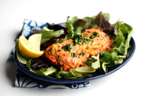 salmon filet on a bed of greens