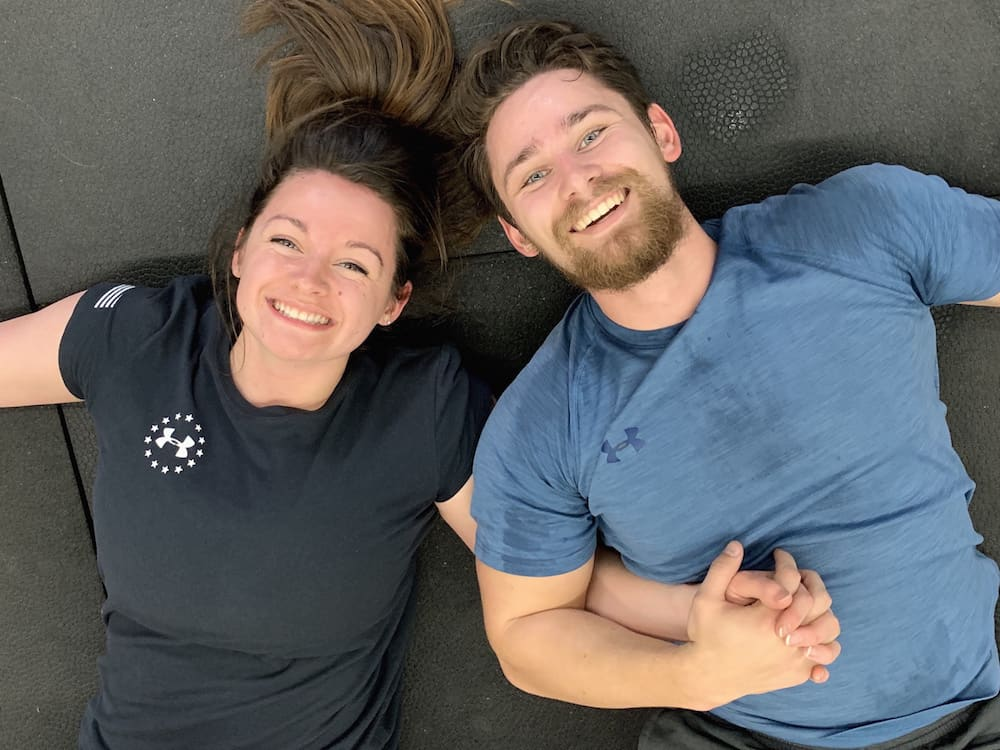happy couple in gym